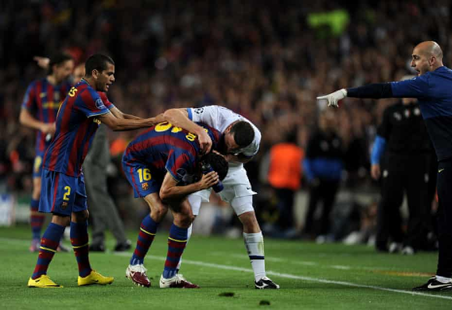 Thiago Motta clashes with Barcelona's Sergio Busquets after being sent off in the Champions League semi-final at Camp Nou.
