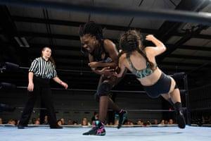 Scott slams professional wrestler Aria Palmer to the mat during Autumn Armageddon 2018 in Galena, Maryland.