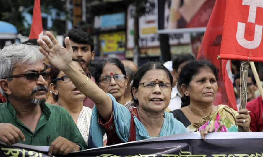 Activists of Communist party of India (Marxist) shout slogans during a nationwide strike in Kolkata, India