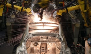 Robotic arms assemble the shell of a Nissan car in Sunderland