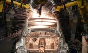 Robotic arms assemble a car at Nissan's Sunderland plant