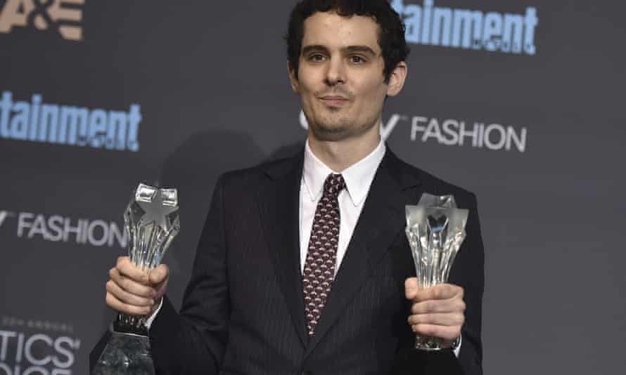 La La Land director Damien Chazelle with his awards for best picture and best director