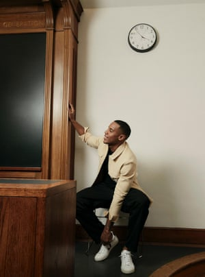 'I was beating myself up more than anybody else': Reggie Yates wears frayed shirt by nanushka.com, T-shirt by studionicholson.com, trousers by Lemaire from harveynichols.com.