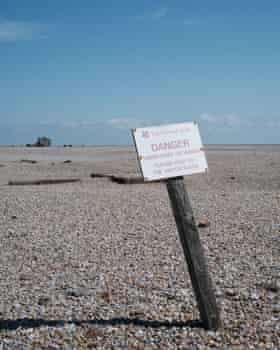 A National Trust sign warning of unexploded ordnance.