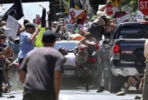 People are thrown into the air as a car drives into a group of protesters demonstrating against a white nationalist rally in Charlottesville, Virginia on 12 August, killing civil rights activist Heather Heyer