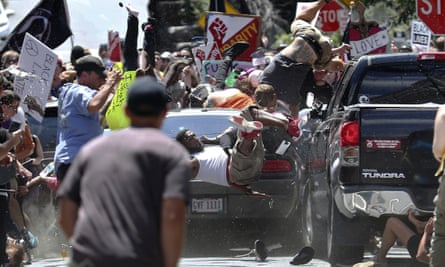 James Alex Fields driving his car into a group of counter-protesters in Charlottesville, Virginia on 12 August. Witness Marcus Martin is in the photo.