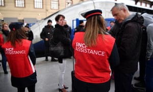 SNCF agents assist a group of commuters waiting on a platform at Marseille-Saint-Charles station.