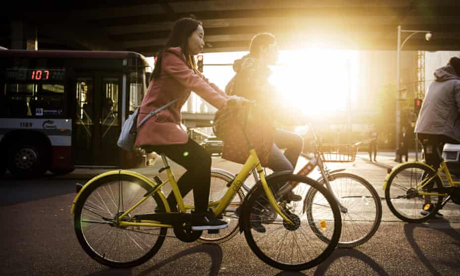 Chinese commuters ride shared bicycles