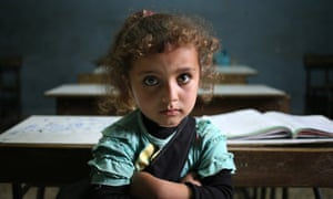 Syrian refugee girl sits in a classroom at a Lebanese public school.