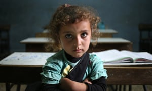 A Syrian refugee girl sits in a classroom in Lebanon.