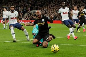 Raheem Sterling takes a tumble after Hugo Lloris's penalty save