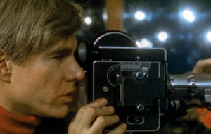 """Andy with Bolex, 1965 (Profile Andy Warhol with Bolex camera , at work filming """"Lupe Velez"""" film in the Dakota apartment building, New York City, 1965)"""