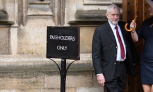 Jeremy Corbyn next to a sign saying 'pass holders only'