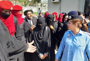 Two Hindu girls leave the Islamabad high court, which ordered the government to provide them with protective custody after their family claimed they were abducted and forced to convert to Islam