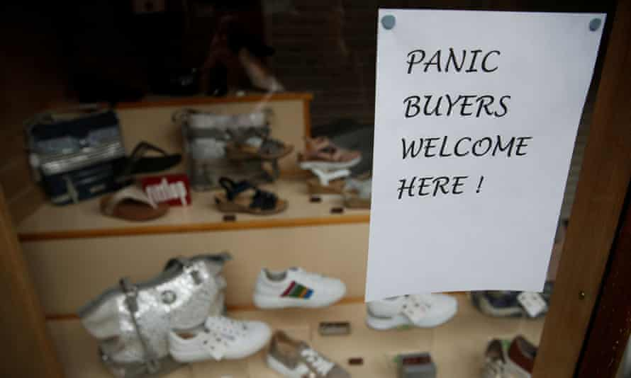 A sign saying 'panic buyers welcome here' on a shop in Knutsford.