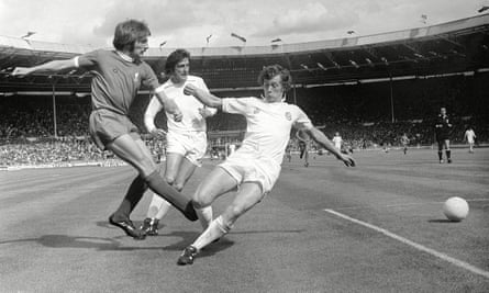 Trevor Cherry tries to stop a cross from Liverpool's Steve Heighway as his Leeds teammate Norman Hunter closes in during the 1974 Charity Shield