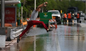Man jumps over puddle in Miami