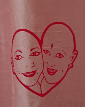The couple's image on a curtain.