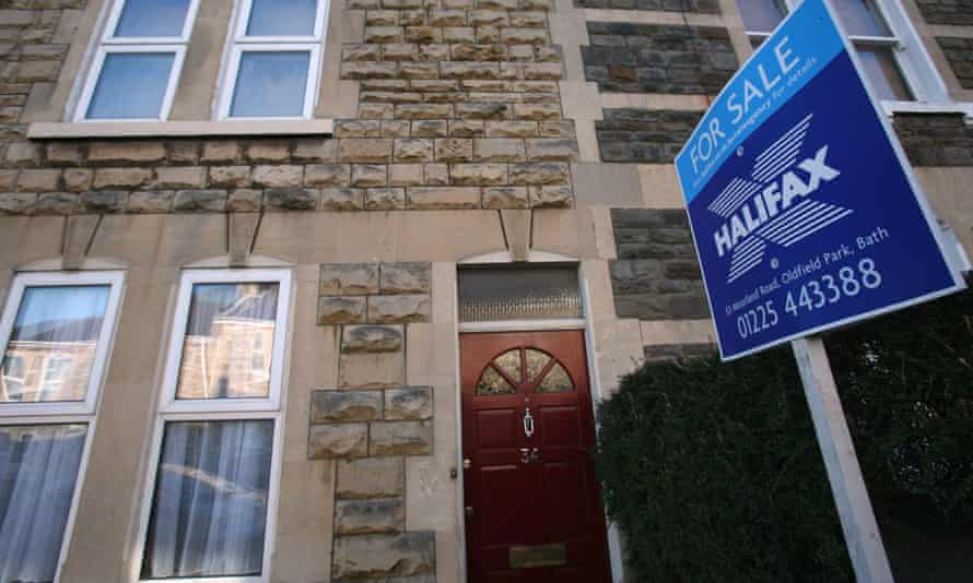 A Halifax estate agent's 'for sale' sign is displayed outside a house on March 3 2008 in Bath, United Kingdom.
