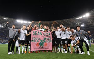 Liverpool players celebrate reaching the Champions League final with the banner for Sean Cox.