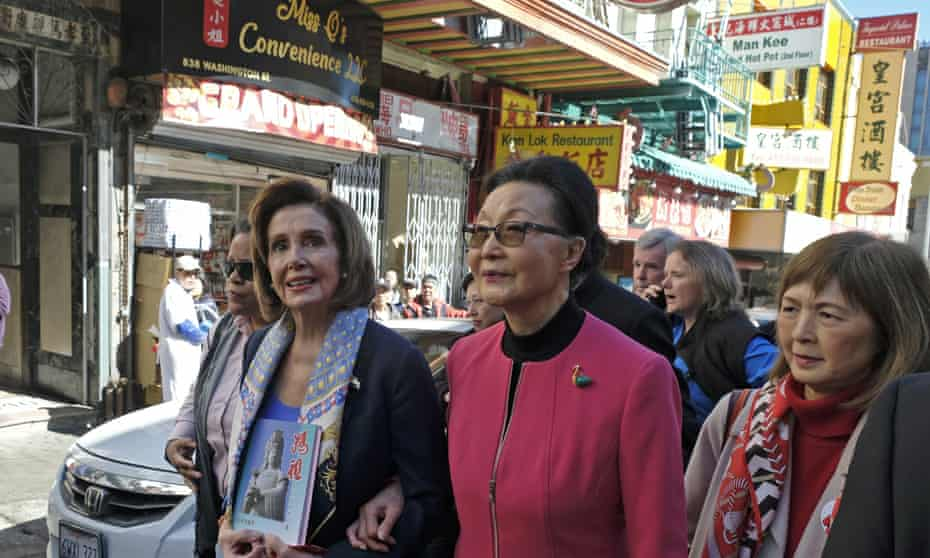 Nancy Pelosi walks with Florence Fang and Claudine Cheng, right, during a tour of Chinatown, 24 February 2020.