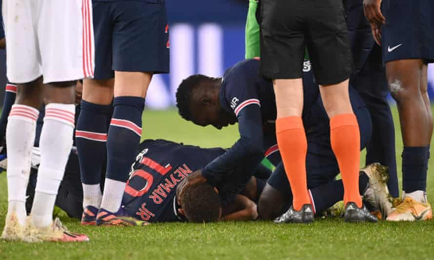 Neymar lies on the floor after a foul by Lyon's Thiago Mendes.