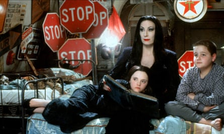 'I took all the fake stuff, made a pile, and set it on fire' … Huston in The Addams Family with Christina Ricci and Jimmy Workman.