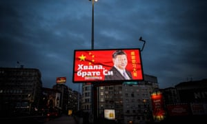 A billboard showing Chinese president Xi Jinping's face next to the words 'Thank you, brother Xi'.