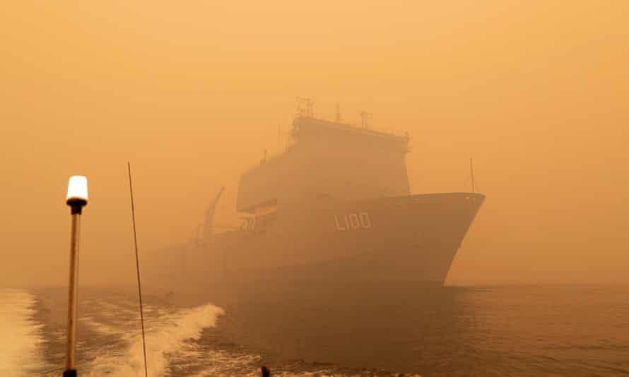 HMAS Choules sails off the coast of Mallacoota,