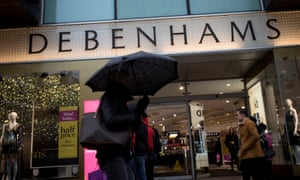 Shoppers walk past the Debenhams department store on Oxford Street in London