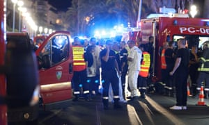 Police officers, firefighters and rescue workers are seen at the site of an attack on the Promenade des Anglais.