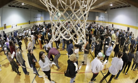 People wait to vote on Super Tuesday in the gymnasium at Cleveland Park Community Center in Nashville, Tennessee, on 3 March 2020.
