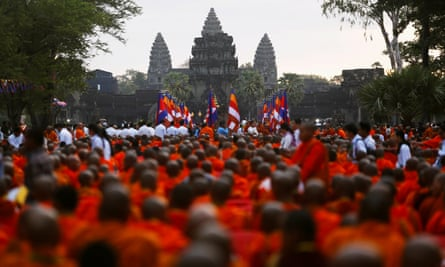 Buddhist monks attend a ceremony at the Angkor Wat temple to pray for peace and stability in Cambodia.