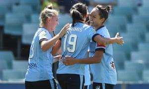 Leena Khamis celebrates with teammates after scoring a goal