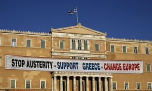 A banner on the parliament building during a pro-government rally calling on Greece's European and IMF creditors to soften their stance in the cash-for-reforms talks in Athens.