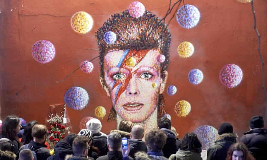 Crowds gather at a Ziggy Stardust tribute to David Bowie following the singer's death last January.