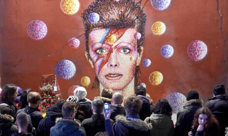 Fans gather at a mural of Bowie in Brixton after his death in January 2016.