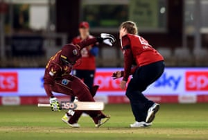England's Anya Shrubsole collides with West Indies' Shemaine Campbelle as she is caught out.