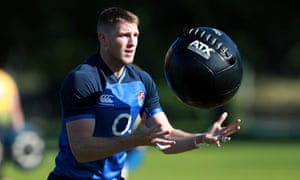 Ruaridh McConnochie works out with a medicine ball during an England training session.