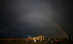 A rainbow is seen behind Stonehenge's stone circle in Amesbury, Wiltshire