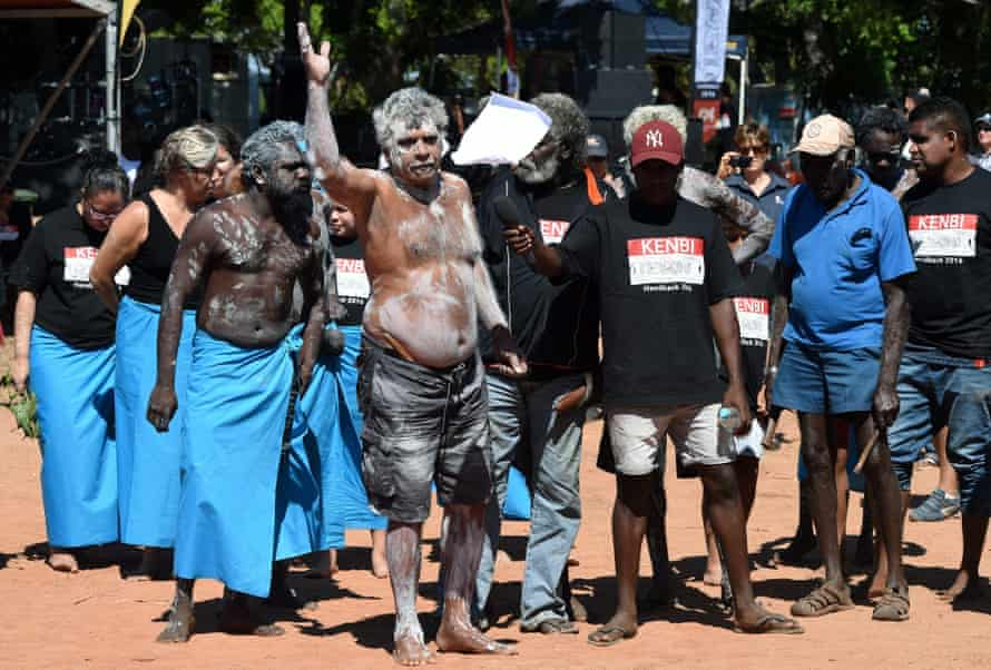Larrakia man Eric Fejo (centre) throws away the Northern Australia white paper during a ceremony to hand back Kenbi land to its traditional owners on Tuesday.