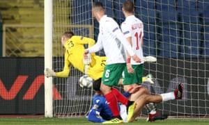 Cyprus' Grigoris Kastanos scores their first goal.