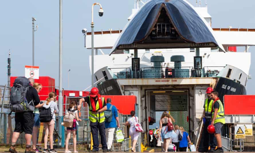 Passengers bound for Arran board the ferry