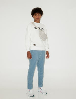 White sweatshirt with WTAPS logo in black from Browns Fashion, pale blue cords River Island, white trainers with blue and red eyelets Topman, light grey bumbag, Herschel