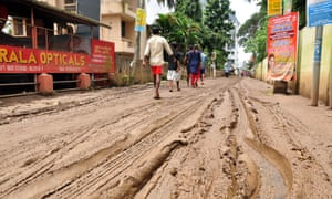 A muddy street in Kochi after the worst monsoon rains in a century.