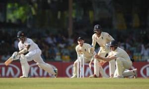 Sri Lanka batsman Roshen Silva watches as the England fielder Keaton Jennings takes the catch