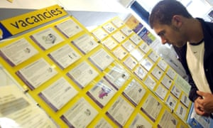 Young man looks at jobs board