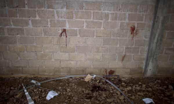 Bullet holes and blood stains in the wall of the warehouse where Mexican soldiers shot dead 22 people.