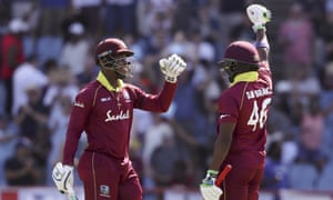 West Indies' Shimron Hetmyer and Darren Bravo celebrate beating England by seven wickets.