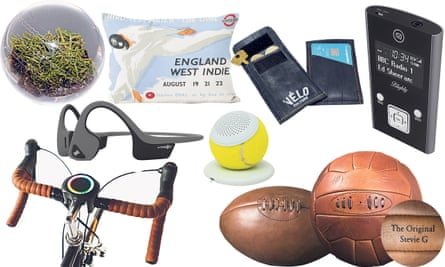 From left: Lord's turf paperweight, Smarthalo bike device - satnav/alarm, Aftershockz Trek Air headphones, London Underground England v West Indies Cricket Test cushion, Hearo tennis ball bluetooth speaker, cyclist's pouch made from innertube rubber by Cake Stop Caddy, personalisable vintage style leather rugby ball and football, Blighty DAB radio.